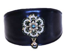 BLACK INSIGNIA COLLAR HAS A EMERALD GREEN & CLEAR CRYSTAL BRASS CENTERPIECE 100% GENUINE LEATHER