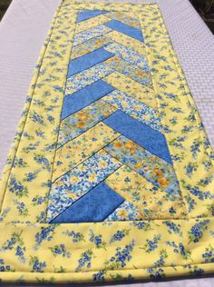 Spring Yellow Table Runner Table Topper in A Blue and Yellow Floral Braided Handmade Homemade Quilt Quilted by Heathersquaintquilts on Etsy https://www.etsy.com/listing/493127278/spring-yellow-table-runner-table-topper
