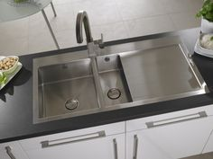 Take an ultra modern sink, such as this Vantage 1.5 bowl stainless steel inset and pair it with a rustic French style kitchen. Add in other modern stainless steel appliances such as a range cooker to achieve that stunning juxtaposition of old and new.