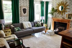 Living room by meghanmerrymorrow.blogspot via littlegreennotebook. Wall stencil, THOSE CURTAINS! great example of a wood fireplace with black surround.