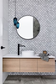 28 Bathroom Wall Decor Ideas to Increase Bathroom's Value wall In this modern bathroom, fish scale tiles (also known as scalloped or fan tiles) have been used to create a decorative accent wall, while the blue light fixture adds a pop of color. Modern Bathroom Tile, Bathroom Interior Design, Bathroom Black, Bathroom Mirrors, Minimalist Bathroom, Bathroom Cabinets, Restroom Design, Marble Bathrooms, Master Bathrooms
