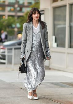 Kat Collings wears silver sequinned dress paired with oversized blazer and white pointed heels.