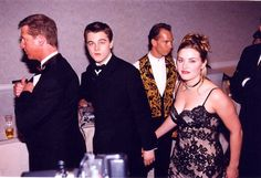 Holding each other's hands, looking surprised. | Proof That Kate And Leo's Love Is The Deepest Love Of All