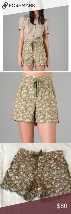 Marc Jacobs Colette Balsam Tan Print Shorts These floral cotton shorts feature a drawstring at the waist and ruching at the front. Welt hip and back pockets. Solid canvas trim. Hidden button and 2 hook-and-eye closures. Marc by Marc Jacobs Shorts