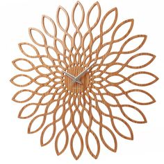 An absolutely stunning wooden sunflower wall clock with intricate petal design.This beautiful wooden wall clock would look fabulous hung in both contemporary or traditional surroundings. The clock is made form MDF and is intricately cut in a pretty petal design. This contemporary wall clock would made a wonderful gift to an interiors addict or alternatively could be the latest addition to your own home. Requires 1 x AA battery which is not includedMDFApprox 60cm D