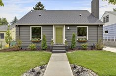 gray exterior, renovated mid-century bungalow-love things green door!