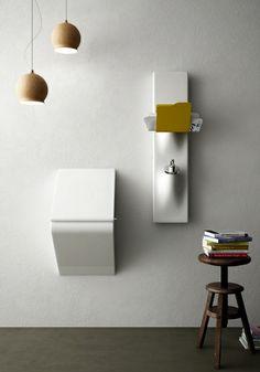 Sotto Sopra design Meneghello Paolelli Associati. Barra ceramica multifunzionale da cui escono in modo fluido gli accessori/ Multi-functional ceramic bar from where accessories smoothly come out #bathroom #design #accessories