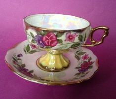 Pedestal Tea Cup And Saucer - Iridescent White And Yellow With Pansies - Gilding