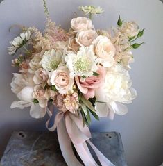 A magical mix of blush pinks and white flowers, tied up with toning ribbons, make this exquisite summer bouquet.