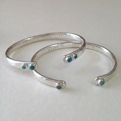 Birthstone Torc Bangles | set with turquoise and aquamarine birthstones - hand forged solid silver with hammered texture. POA * Bespoke * Honeybourne Jewellery.