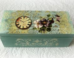 Decoupaged wooden box, perfect as a jewelry box or tea box,with with removable dividers inside. Hand painted with acrylic paints,wood stain and antique paste,decoupaged with a rice paper. Decorated with beautiful chipboard decor on the front.  Protected with acrylic varnish. The colors may slightly vary on your display. Size:21.5cm x 16cm, h: 7.5cm  Thank you for visiting my shop :)