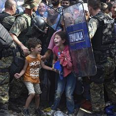 Hundreds of migrants trying to cross the border from Greece to Macedonia clashed with police lines on Friday, just a day after Macedonia declared a state of emergency and closed the border