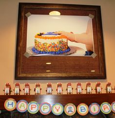 We covered all the pictures in the clubhouse with photos from Easton's smash cake birthday photo shoot. - Robot Birthday Party