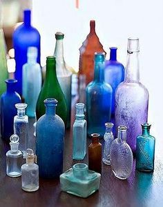 Antique Bottles Vintage bottles are a wonderful way to add a pop of color to any table setting. Add a flower stem or two and its a very cost effective way to add flowers to a table setting. Colored Glass Bottles, Antique Glass Bottles, Blue Bottle, Bottles And Jars, Glass Jars, Perfume Bottles, Coloured Glass, Vodka Bottle, Antique Glassware