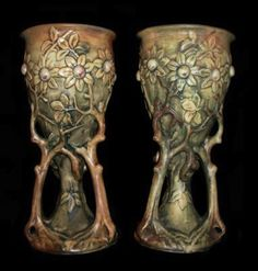 Earth Witch:  #Earth #Witch ~ Beautiful pair of of well colored and detailed figural tree chalice vases supported by flowering trunk and branches. 1920's Woodcraft line, model illustrated page 157 Huxford's Weller pottery book.