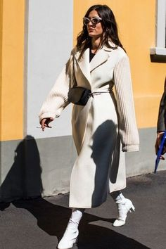 Loving this sand coat wrapped with a belt bag and paired white sock boots! Curated by @sommerswim
