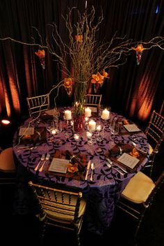 Elegant Halloween Wedding - interesting table cloth, and I like use of candles