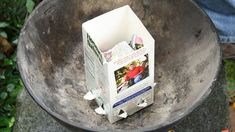 Get your charcoal started with an old juice or milk carton! A little newspaper in the middle and you're ready to start grilling!
