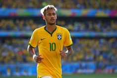 Neymar Photos Photos - Neymar of Brazil looks on during the 2014 FIFA World Cup Brazil round of 16 match between Brazil and Chile at Estadio Mineirao on June 28, 2014 in Belo Horizonte, Brazil. - Brazil v Chile: Round of 16 - 2014 FIFA World Cup Brazil