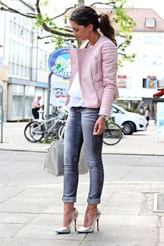pink leather jacket, white top, grey jeans, silver bag and shoe