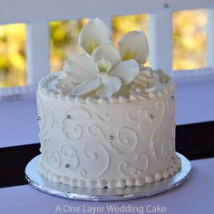 one layer wedding cake - for the wedding luncheon.  Some scrolling design and we could lay some fresh flowers in your pink and orange around it