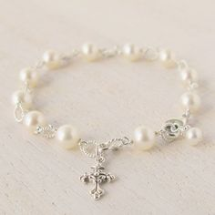 A beautiful pearl and sterling silver rosary bracelet for her First Holy Communion.  The perfect gift for her special day.