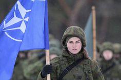 Estonian soldier holding a NATO flag [1280 x 853]
