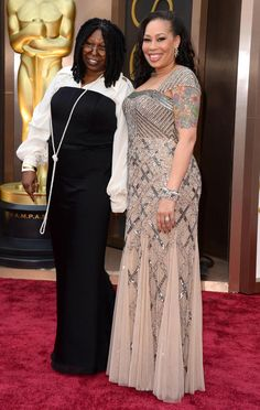 Whoopi Goldberg and Alex Martin arrive at the 86th Annual Academy Awards at the Dolby Theatre in Hollywood on March 2, 2014.