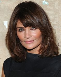 Helena Christensen's long bob with side-swept bangs which are flattering to her eyes and square face shape.