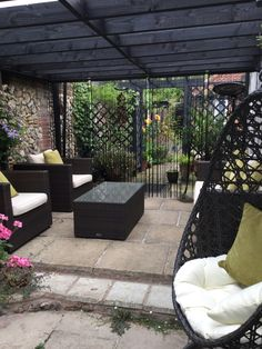We love this little hideout Bev has created in her garden. Lovely dark tones on the stained wood match the Rattan furniture perfectly.  Bevs garden | Primrose Gardens