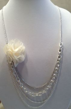 20s Inspired Four Strand Wedding Bride Necklace. Silver Chain, Rhinestone strand, Cream Flower. $30.00, via Etsy.