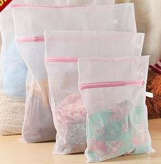 Lingerie Bags for Laundry. Keep All Your Delicates Looking Like New with a Set of 4 Mesh Laundry Bags for Lingerie, Socks, Pantyhose, Baby Clothes and Stuffed Toys. Use in Both Washing Machine and Dryer. Highest Quality Fine Mesh Zippered Bags. (Color: White)