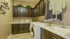 Huge #laundryroom with a gorgeous and luxurious amount of #cabinetspace and a #sink right there!