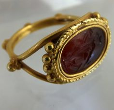 "Late Roman gold ring ca 400 A.D. Set with carnelian intaglio of the goddess Fortuna. Measurements of bezel: 17 x 12 mm Ring size : ""O"" + 1/2 = US 7 + 1/2"