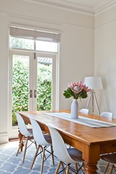 Chairs, wooden table, rug and of course kind proteas - for 19C dining area at end of kitchen