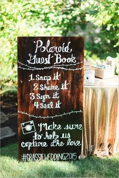 Polaroid wedding guestbook ideas; but what I love about this sign is that they have painted string lights to break up the writing