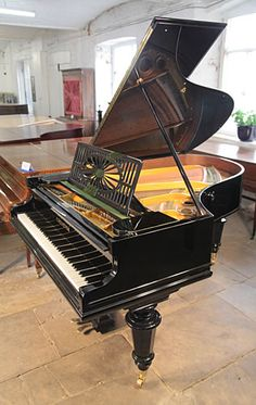 A restored, 1899, Bechstein Model A grand piano with a black case and turned legs at Besbrode Pianos £15,000.