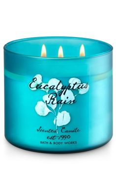 """Eucalyptus Rain - 3-Wick Candle - Bath & Body Works - The Perfect 3-Wick Candle! Made using the highest concentration of fragrance oils, an exclusive blend of vegetable wax and wicks that won't burn out, our candles melt consistently & evenly, radiating enough fragrance to fill an entire room. Candle comes in colorful frosted glass and is topped with a flame-extinguishing lid. Burns approximately 25 - 45 hours and measures 4"""" wide x 3 1/2"""" tall."""