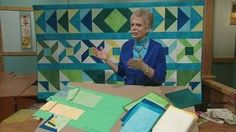 Trusty Triangles - A Row-by-Row Sampler Quilt, Part 1 | Nancy explains how to arrange simple half-square triangles into beautiful row-by-row designs. Learn how to make half-square triangles, and assemble three rows of a six row sampler quilt. Designs include - Opposing Arrows, Teetering Triangles, and Twirling Triangles.