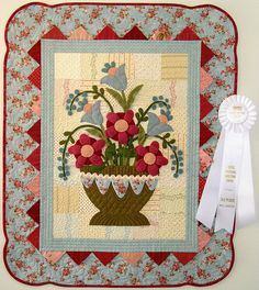 Woolie Flowers place HMQS 2009 ~ wool flowers appliqued onto a patchwork Felt Applique, Applique Quilts, Small Quilts, Mini Quilts, Quilting Projects, Quilting Designs, Wool Quilts, Barn Quilts, Medallion Quilt