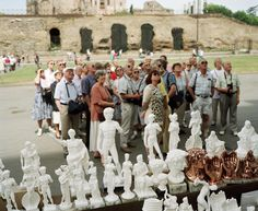 "ITALY. Rome. Colosseum. Statues and tourists at the Colosseum. 1993 Martin Parr, ""Small World"""
