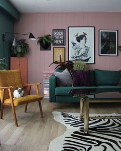 Love that pink wall - paint over paneling - especially downstairs - looks great - white for a cottage look, pink and pastels for a 60's mod vibe. This place hits all my faves. #home #decor #retro #budget #downstairs #basement #den #renovation #bungalow #70s #60s #pink #green