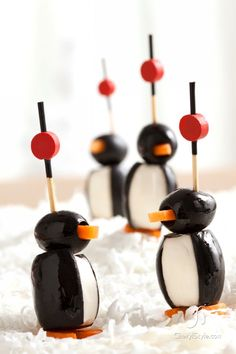 So cute for New Years: Penguin Poppers with black olives, cream, and carrot #newyears #partyfood