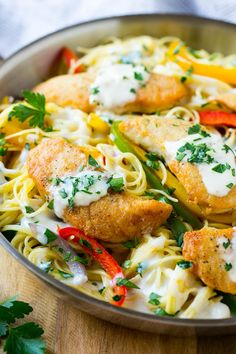 This chicken scampi is golden brown tenderloins with peppers and onions over creamy pasta. It's a restaurant favorite that tastes even better when you make it at home!