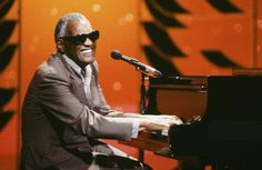 Ray Charles performs on June 9, 1987; Rhythm & Blues titan Ray Charles (1930 - 2004) was born in Albany, Georgia, and would grow up in Greenville and Tallahassee, Florida before living in Los Angeles and Seattle, where he first gained musical traction.