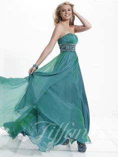 Divine straight across neckline dress with a ruched empire bodice. Exquisite crystal rhinestone detailed waistband. Full length A-line style skirt with elegant side front slit. www.tiffanydesigns.com