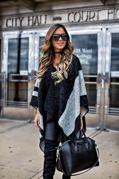 fashion blogger Mia Mia Mine in a sole society poncho and black leather pants