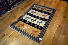 Hand Woven Qashgai Kilim from Iran (Persian). Length: 150.0cm by Width: 97.0cm. Only £265 at https://www.olneyrugs.co.uk/shop/kilims-for-sale/persian-qashgai-18596.html    Take a look at our ravishing collection of wall hanging rugs, carpets, kilim foot stools and Kilim cushion covers at www.olneyrugs.co.uk