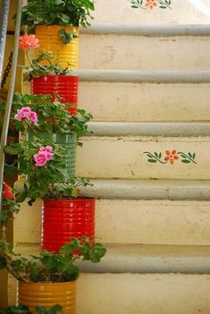 Ok..this is just too pretty!  painted coffee cans...how fun and the pretty stencil on the steps