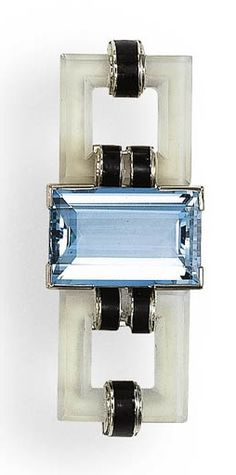 AN ART DECO AQUAMARINE, ROCK CRYSTAL AND BLACK ENAMEL BROOCH – Christie's Centering upon a rectangular-cut aquamarine flanked by carved rock crystal of square outline, accented by black enamel bands, mounted in white gold, circa 1930, in its original Gustave Sandoz fitted black leather box